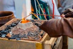 Lampwork on open fire. Handicraft of glass bead on open fire Stock Photo