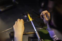 Lampworking - artistic treatment of glass in the flame. Woman ma Stock Photo