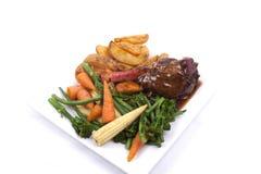 Lamssteel met groente Stock Foto's