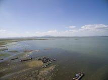 Lamtakong lake shore with boats and blue sky Stock Image