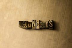 LANÇAMENTOS - close-up vintage sujo da palavra typeset no contexto do metal Foto de Stock
