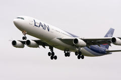LAN Airlines Airbus A340-300 in flight. Chilean Airline LAN Airlines Airbus A340-300 in flight with landing gear Royalty Free Stock Image