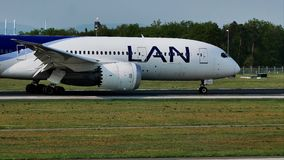 LAN Airlines plane taxiing on runway, Frankfurt, FRA. LAN Airlines jet doing taxi on runway, Frankfurt Airport, FRA, Germany, woods background stock video footage