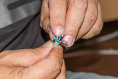 LAN cable preparation. A male hand preparing a LAN cable Royalty Free Stock Photo