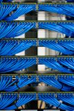 LAN cable wiring and networking in data center. LAN cable wiring and networking in the network or server rack in the data center Royalty Free Stock Photography