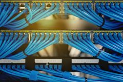 LAN cable wiring and networking in the data center. LAN cable wiring and networking in the network or server rack in the data center Stock Image