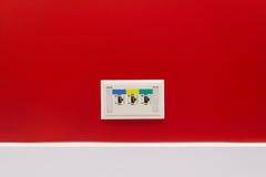 LAN hub in office. Port LAN hub on red wall in office Stock Photos