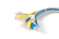 LAN Network cable with RJ-45 connector. Network cables Group with an RJ-45 connector used for the creation of local networks and hook up to the Internet via TCP Stock Image