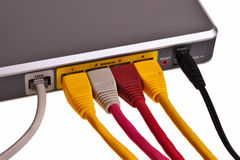 LAN switch back panel. LAN switch back panel with RJ45 patchcords isolated over white background Stock Images