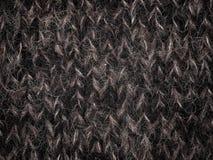 Lana tricottata, filo di lana nero Immagine Stock
