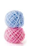 Lanas en azul y color de rosa Imágenes de archivo libres de regalías
