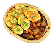 Lancashire Hotpot. Traditional potato topped Lancashire hotpot isolated on a white background Royalty Free Stock Photo