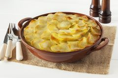 Lancashire Hotpot on White. Lancashire Hotpot - regional speciality Lancashire Hot Pot, lamb and vegetables topped with sliced potatoes and oven baked, in a Stock Photo