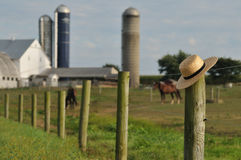 Lancaster Amish farm with straw hat stock photography