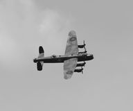 Lancaster Bomber in flight. World War 2 Avro Lancaster Bomber in flight in 2012. View showing the top and side of the aircraft in flight Royalty Free Stock Image
