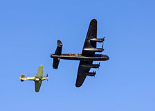 Lancaster Bomber and Hawker Hurricane Fighter Escort Stock Photography