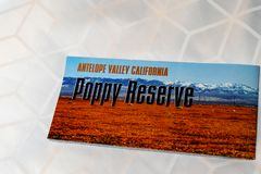 Paper pamphlet from the Antelope Valley Poppy Reserve sits on a bed. Concept for. Lancaster, California -  Paper voucher pamphlet from the Antelope Valley Poppy stock photography