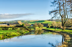 Lancaster Canal Cumbria. Lancaster Canal near Crooklands, Cumbria, England wending its way through verdant agricultural countryside on a sunny day with blue sky Royalty Free Stock Image