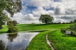 The Lancaster canal passing through rural countryside. royalty free stock image