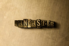 LANCASTER - close-up of grungy vintage typeset word on metal backdrop Stock Photography