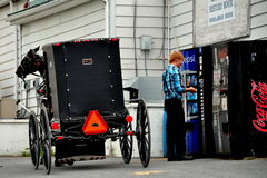 Lancaster County, PA: Amish Youth Buying Pepsi Royalty Free Stock Photography