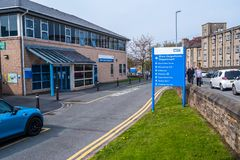 Lancaster england uk april 18 2019 Hospital sign giving directions to different departments. Lancaster england uk april 18 2019 blue Hospital sign giving royalty free stock photos