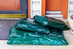 LL Bean Packages Delivered at a Home. Lancaster, PA, USA - December 7, 2018: Closeup of LL Bean packages delivered at a residential door stock photos