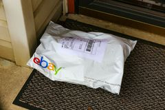EBay Pack at Front Door. Lancaster, PA, USA - December 4, 2017: An ebay pack delivered at a front residential door Stock Photography