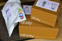 EBay Packages Delivered at Door. Lancaster, PA, USA - December 4, 2017: Multiple ebay packages delivered to a residential front door Stock Image
