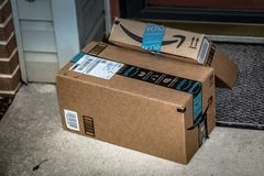 Two Amazon Prime Delivery brown boxes stock photos
