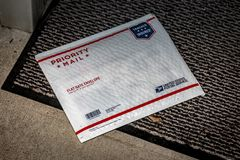 USPS Priority Mail envelope. Lancaster, PA, USA - December 15, 2017: USPS Priority Mail padded envelope package delivered at a residential home front door royalty free stock photos