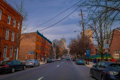 LANCASTER, USA - APRIL, 18, 2018: Outdoor view of cars parked at one side of the road with some downtown Lancaster. Pennsylvania in a cloudy day stock images