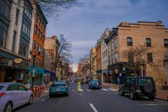 LANCASTER, USA - APRIL, 18, 2018: Outdoor view of cars parked at one side of the road with some downtown Lancaster. Pennsylvania in a cloudy day royalty free stock images