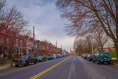 LANCASTER, USA - APRIL, 18, 2018: Outdoor view of cars parked at one side of the road with some downtown Lancaster. Pennsylvania in a cloudy day royalty free stock photos