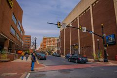 LANCASTER, USA - APRIL, 18, 2018: Outdoor view of people waiting to cross the street with some cars parked at one side. Of the road with some downtown Lancaster royalty free stock images