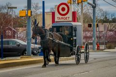 LANCASTER, USA - APRIL, 18, 2018: View of amish carriage in the city, known for simple living with touch of nature. Contacy and reluctance to adopt conveniences Royalty Free Stock Image