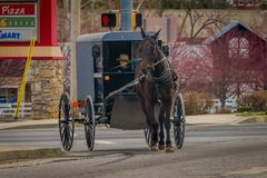 LANCASTER, USA - APRIL, 18, 2018: View of amish carriage in the city, known for simple living with touch of nature. Contacy and reluctance to adopt conveniences Stock Photography