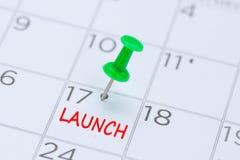 LANCE escrito em um calendário com um pino verde do impulso para lembrá-lo imagens de stock