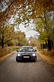 Lancer X on the Autumn Road Royalty Free Stock Images