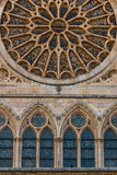 Lancet arch windows under the main rose window of the Cathedral. Lancet arch shaped windows and main rose window with ist stained glasses in the gothic cathedral Stock Photo