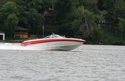 Lancha de carreras en el lago Fotografía de archivo