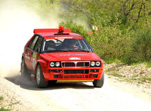 Lancia Delta HF rally car. Giuseppe Grossi of Italy  with Alessandro Pavesi  (co-pilote) drives his Lancia Delta HF as safety car during the sixth stage of the Stock Photography
