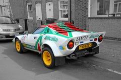 Lancia gesponsorde raceauto stock afbeeldingen