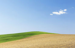 Land. With blue sky and clouds Royalty Free Stock Photography