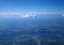 Land from above. Aerial photo of land and clouds from above Royalty Free Stock Images