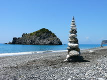 Land-art on beach in Calabria. Some land art on beach from unknown artist near Dino island Stock Image