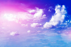 Land, blue sky and beautiful clouds Stock Photo