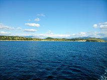 Land and blue sky and sea. In Ionian sea Greece Stock Photos