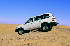 Land Cruiser in the desert.. Side view of car.  Horizontal orientation Stock Images