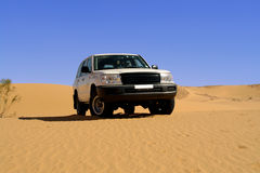 Land Cruiser in the desert.. Low-angled shot of front end of the car. Horizontal orientation Stock Photography